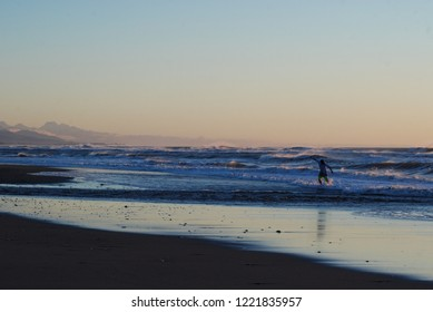Skim Boarder catching the last rays of light, Greymouth New Zealand.