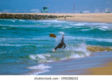 skim boarder wipeout at the beach
