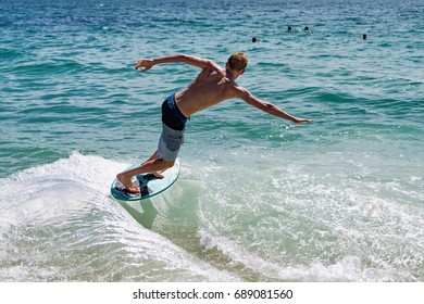 Skim boarding in Laguna Beach Southern California