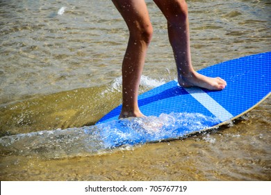Skim boarding on beach