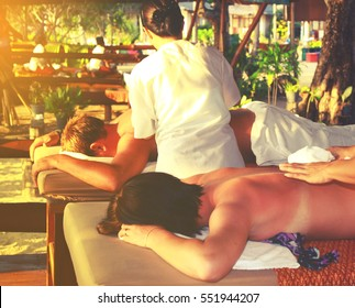 Skin And Body Care Beautiful young couple enjoy together a massage at beach spa.