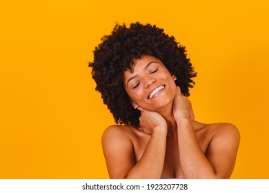 Skin care. Afro woman smiling with perfect skin.