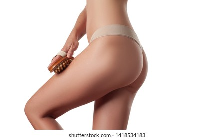 Skin care and anti cellulite treatment. Perfect female buttocks without cellulite in panties. Woman make anti cellulite massage.