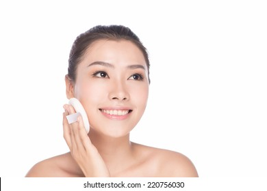 Skin care beauty woman. Beauty woman smiling applying cream. Beauty portrait of beautiful Asian / Caucasian female model isolated on light white background looking at copy space.