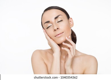 Skin care concept. Beauty and spa for body and face. Beautiful smiling tender young woman with fresh clean skin on white backgroung. Woman health life