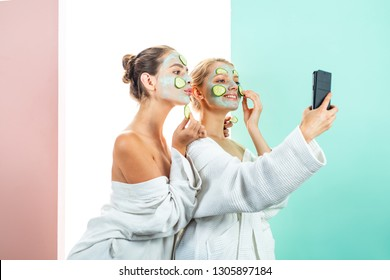 Skin care concept. Face cream. Portrait Of two Beautiful Young Female Models With Natural Facial Makeup. Beautiful Young Woman Face With Fresh Skin