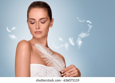 skin care concept. Happy woman with clean glowing skin. Soft and smooth body protection. Portrait of beauty brunette with pen in hand