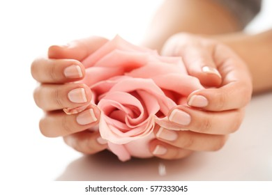 Skin care. Hands with pink rose head