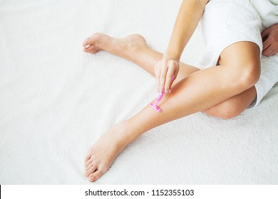 Skin Care and Health. Hair Removal. Fit Woman Shaving Her Legs With Razor.