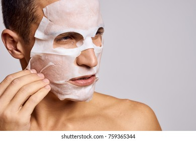 skin care, a man in a cosmetic mask
