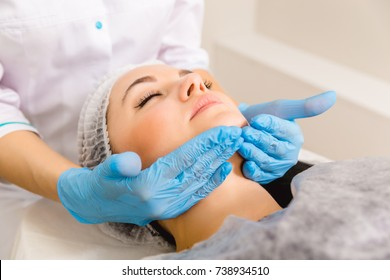 skin care, medical beautician makes facial massage