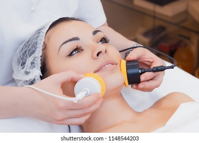 Skin Care. Microcurrent therapy. Beautiful young girl on the procedures for skin care. Hardware cosmetology. Cleaning of the face skin in the spa