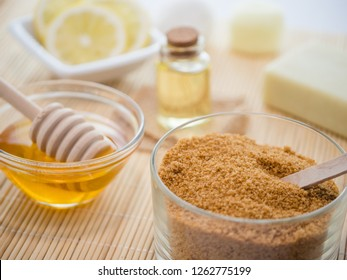 skin care natural products ingredients for scrub body mask: honey, lemon juice, brown sugar, almonds oil