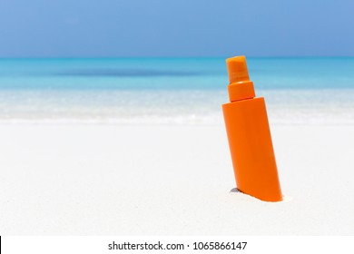Skin care on summer vacations. Tube with sun screen SPF protection lotion on tropical sea shore. Copy space for your text