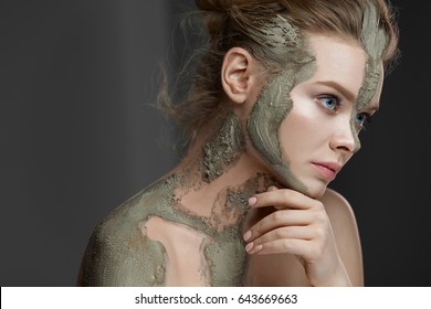 Skin Care. Portrait Of Sexy Young Woman With Natural Clay Mask On Face And Body. Closeup Of Beautiful Female With Fresh Makeup And Perfect Skin Receiving Body Skin Care Spa Treatment. High Resolution