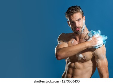 Skin care, spa, beauty, people concept - sexy macho, unshaven man, muscular attractive bearded hipster in boxer shorts washes in shower. Starting day. Natural athlete showering.