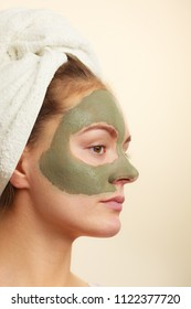 Skin care. Woman face with green clay mud mask. Girl taking care of oily complexion. Beauty treatment.