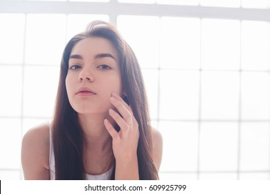 Skin care for a young woman and a morning makeup.