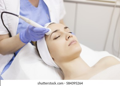 Skin care. Young woman receiving facial beauty treatment. Facial therapy. Anti-aging procedures.
