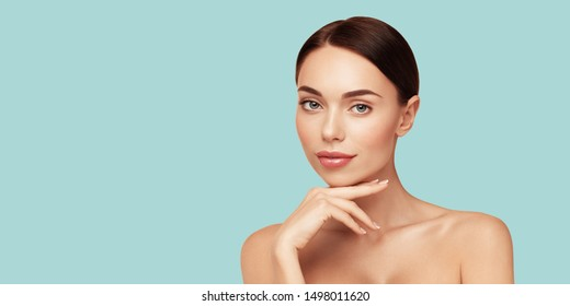 Skin care,Beauty treatment and spa concept. Attractive model with brown hair and  Clean Fresh Skin touch own face