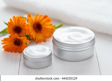 Skin cleansing cosmetic cream with calendula flowers vitamin spa lotion natural organic herbal moisturizer product. Medical dermatology anti aging, acne, blemish, pimple, blackhead clear treatment