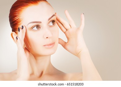 skin lifting concept, red haired woman
