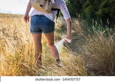 Skin protection. Hiker applying insect repellent against tick and mosquito in nature. Prevention against mosquito bite.