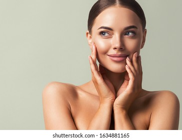 Skin tone woman face healthy skin beauty eyes lips close up hand manicure nails
