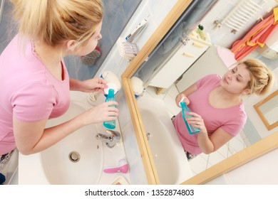 Skin toning, proper pH complexion concept. Woman applying tonic on cotton pad