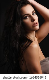 skincare, makeup and haircare concept - natural beautiful brunette woman portrait on dark background