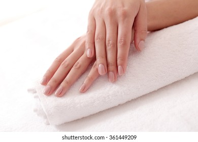 Skincare. Soft and clean hands on a white towel