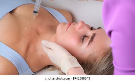 Skincare - woman cleavage massage at salon