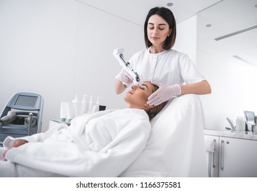 Skincare for you. Attractive young woman laying on daybed at cosmetologist cabinet while having beauty procedure