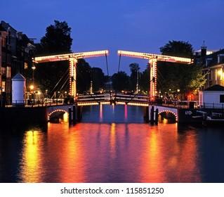 Skinny Bridge (Magere Brug) at dusk & River Amstel, Amsterdam, Holland, Netherlands, Europe