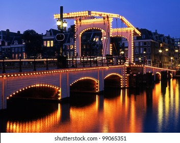 The Skinny Bridge (Magere Brug) at night, Amsterdam, Holland, Netherlands, Europe.
