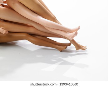 Skinny doll legs on the white background