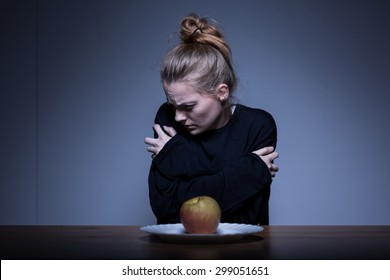Skinny girl afraid of eating and obsessed with weight
