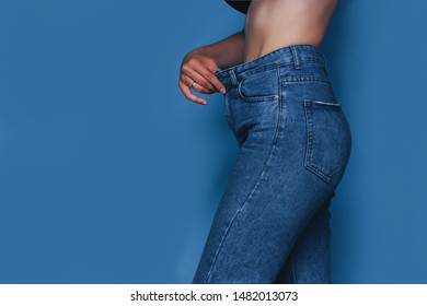 skinny woman body with Loose pants jeans, Light weight body with loose clothes, slender and Healthy body low fat concept.