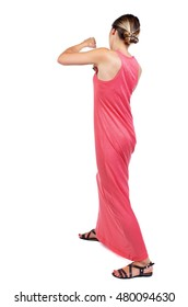 skinny woman funny fights waving his arms and legs. slender woman in a long red dress fights.