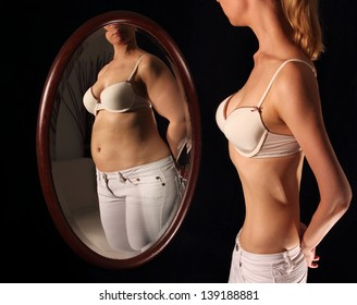 Skinny woman seeing herself fat in a mirror