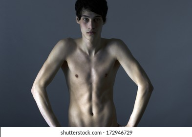 Skinny young man posing fashion, anorexic look, slim body