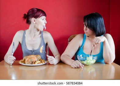 Skinny young woman eating whole chicken overweight woman eating salad
