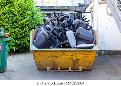 A skip full of office chairs. Take a seat, office closure. Business closure concept, bankrupt