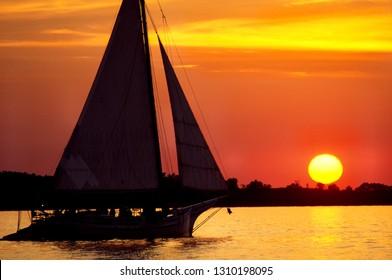 Skipjack under full sail at sunset on the Chesapeake Bay, Talbot County, Maryland, USA