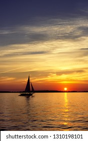 Skipjack under full sail at sunset on the Chesapeake Bay, Talbot County, Maryland, USA