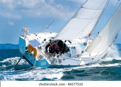 skipper sailing on  yacht at regatta