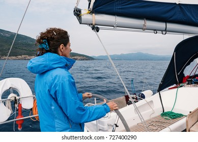 Skipper woman portrait on sailing boat.