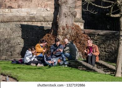 Skipton, England - 02 Feb 2019: Skipton family time next to the holly trinity church, during warm sunny day