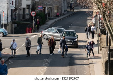 Skipton, England - 02 Feb 2019: Skipton people crossing road on red light