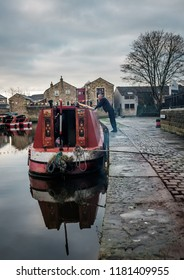 Skipton, England - 30  December 2014: Vintage narrowboat reflected in the canal in Skipton